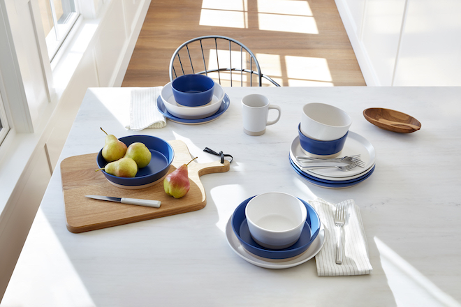 Different size bowls, cups, and other pieces from the Gap Home collection sit on a tabletop.