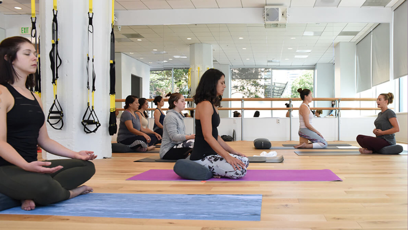 Employees Inside Athleta Taking a Yoga Class