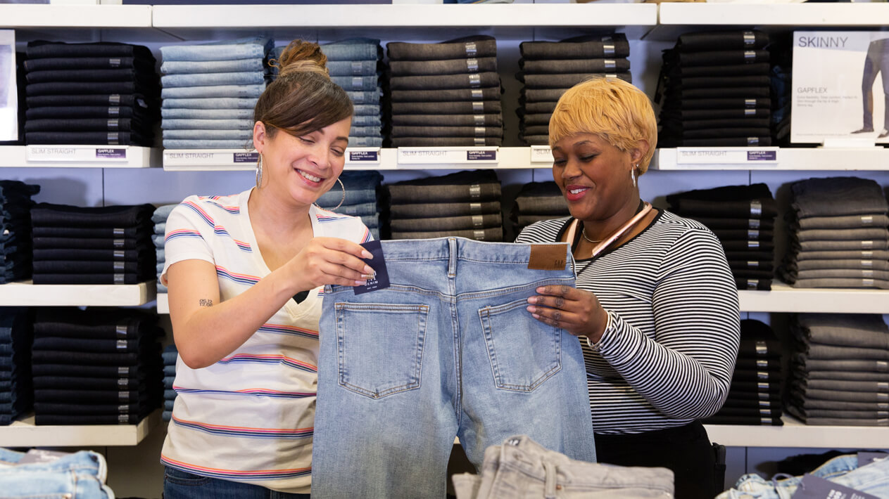 Two Employees Looking at Clothes