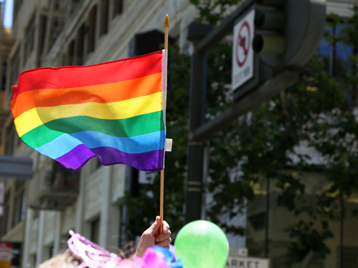 Rainbow Flag Flying in a Pride Parade