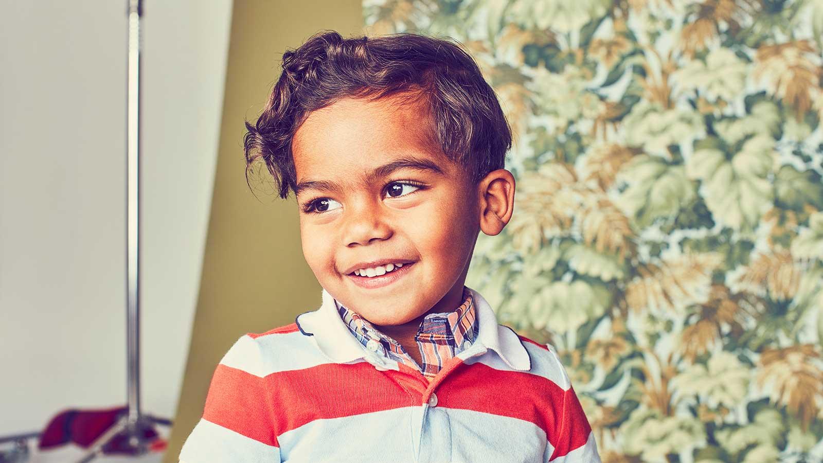 Young boy wearing a stipped shirt