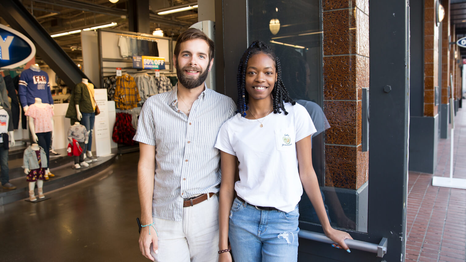 Old Navy Employees Smiling in Front of Door