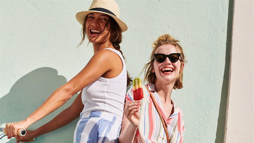 Two Women Posing with a Bike