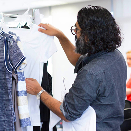 Designer looking through clothes