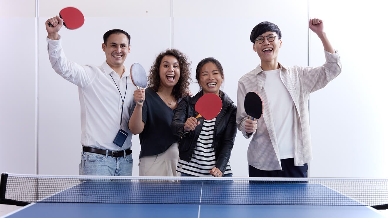 Team Playing Ping Pong Together