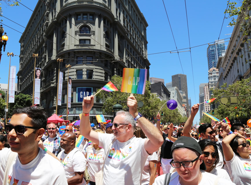 People marching in a Pride Parade