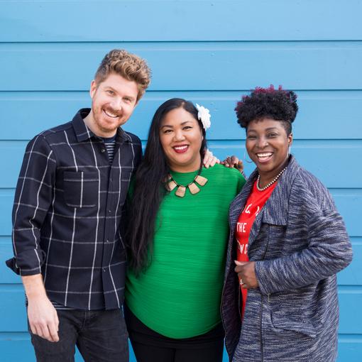 Three Employees Smiling at Camera