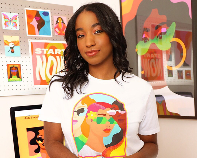 Jade Purple Brown wearing shirt she designed